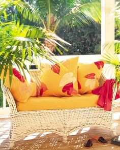 Leafy Sunroom Pillows - For these sunroom pillows, mustard-yellow linen was printed with three different-size anthurium leaves.