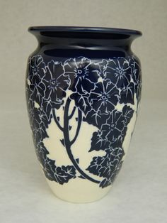 Wild Rose vase by Ken Tracy. Wheel thrown pottery with hand carved cobalt floral design.