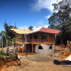 Our house mid-construction. Earthbags on bottom, bamboo frames for wattle-and-daub on top.