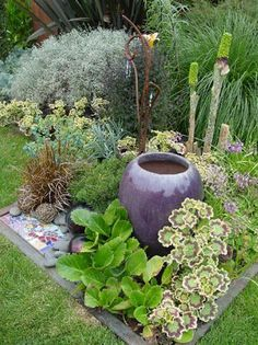 Great idea for incorporating a water feature and plants in a confined area.