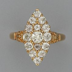 A late Victorian diamond ring The marquise-shaped band pavé-set with brilliant-cut stones, carved shoulders