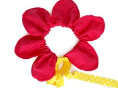 How To Make a Flower Halloween Costume: Push the petals together so that they make a circle. Tie the ribbon ends together and you now have a flower petal headband to complete your costume. Simply tie around your child's head to secure.  From DIYnetwork.com