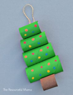 Toilet Paper Roll Christmas Tree Craft is part of Easy Upcycled Crafts Toilet Paper Rolls - Turn your recycled toilet paper rolls into a fun and creative Christmas tree craft Creative Christmas Trees, Christmas Tree Crafts, Preschool Christmas, Christmas Activities, Simple Christmas, Kids Christmas, Holiday Crafts, Christmas Ornaments, Christmas Decorations For Classroom