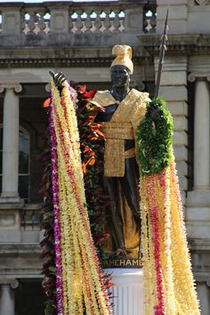 King Kahmehameha Statue draped in leis on King Kamehameha day, Hononlulu, Oahu