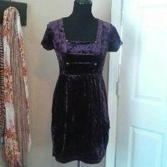 Forever 21 deep purple dress. Polyester and spandex dress but feels like crushed velvet almost. Has 2 deep pockets on the front of dress. Forever 21 Dresses