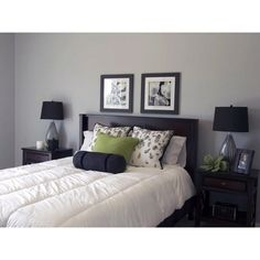 Gray bedroom with green accent