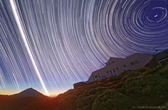 Sun and stars streak the Canary Islands sky on the vernal (Spring) equinox, 2011. Long exposure photo by Juan Carlos Casado, TWAN