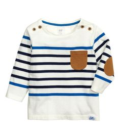 Natural white/striped. Long-sleeved T-shirt in cotton jersey with buttons at…