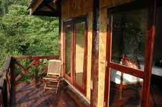 Chill out with a good book on the deck at Nong Kiau Riverside Bungalows in #Laos.
