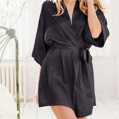Black VS Silk Kimono Robe Victoria Secret Kimono style black silk robe. For a hint of drama and nighttime glamour slip on this soft, silky wrap. Wide sleeves and a short shape make it the perfect addition to your lingerie wardrobe.  Side pockets Mid-thigh length Removable tie at waist Imported polyester Victoria's Secret Intimates & Sleepwear Robes