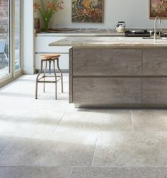 Carnaby limestone flagstones in a modern kitchen. From Ca' Pietra.
