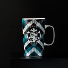 A ceramic coffee mug with a classic plaid pattern design. Part of the Dot Collection.
