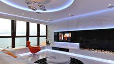 wohnzimmer design weiß schwarz blaue led beleuchtung