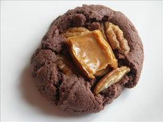 Caramel Nut Brownie Cookies. I am going to try this but chop up the pecans and put those in the batter and try to find mini caramel bites to add to the batter as well...