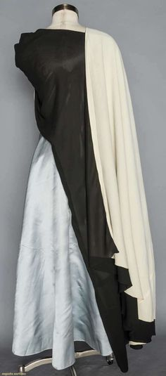 1938 Black silk satin w/ bust length F cape, floor length in back, ovoid opening for head, ivory satin lining