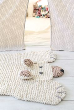 polar bear rug (hilarious!)  Imagine how cute (and expensive o.O) it would be to use that faux fur yarn!