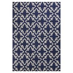 """Adorned with an intricate geometric motif and highlighted by a chic navy palette, this hand-tufted wool rug brings visual interest to your living room or master suite.  Product: RugConstruction Material: WoolColor: NavyFeatures:  Hand-tufted0.5"""" Pile heightLoop pile  Note: Please be aware that actual colors may vary from those shown on your screen. Accent rugs may also not show the entire pattern that the corresponding area rugs have.Cleaning and Care: Regular vacuuming and spot cleaning ..."""