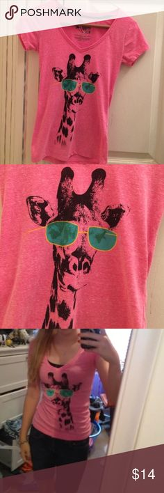Giraffe Shirt Giraffe V-Neck shirt. Only worn a few times and in great condition!  NO TRADES. NO HOLDS. NO MERC@RI  Please make any offers through the offer button   Questions? Just ask! EVERYTHING MUST GO! Ask me about my bundle discounts!  Tops Tees - Short Sleeve