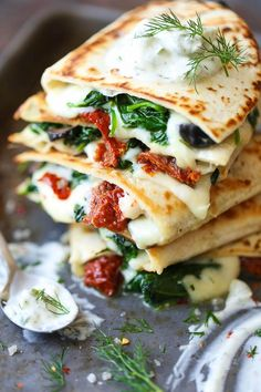 Greek Quesadillas - All the best Greek favors come together in this EPIC cheesy quesadilla, topped with an easy homemade Greek yogurt tzatziki sauce! Food Recipes For Dinner, Food Recipes Deserts Mexican Food Recipes, New Recipes, Cooking Recipes, Healthy Recipes, Vegetarian Greek Recipes, Dinner Recipes, Lunch Recipes, Healthy Meals, Recipies