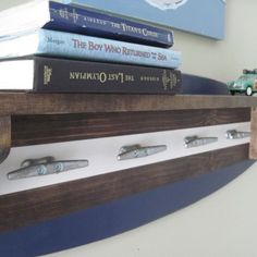 Boat cleat surfboard wall shelf. What better way to combine function and art than in this piece. #coastaldecor #surf #wallshelf