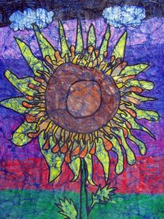 3rd gr. students observed and drew sunflowers in a composition that filled the space of their paper. Then, they applied layers of crayon, coloring heavily and blending colors. After wrinkling their paper to crack the wax, they applied paint and then rinsed it off to create a batik-like effect. Beautiful!