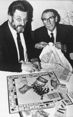 WW II Secrets - In this 1985 photo, John Powell Davies and Colonel James Yule, former prisoners of war at Colditz, examine a Monopoly board at a 50th anniversary celebration of the Hasbro board game, in London. During World War II, doctored Monopoly boards like the one seen here were sent by British intelligence to POW camps in parcels for the prisoners to help them escape. The boards were used to hide currency of the enemy country, silk maps and minute files and hacksaws.