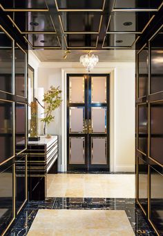 Black paneled walls against a bold floor for a luxe vibe | archdigest.com