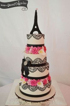 I like the 4-tier cake with the effiel tower on top and the lace type detail