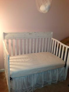 This was my daughters cherry wood crib, chalk painted in white sanded and distressed and converted to her toddler bed  Love the outcome !