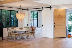 A custom White Oak Plank Dutch-Door opens into an open space that leads to a beautiful Dining Room with black windows Ship Lap Walls, Interior Design, Door Paint Colors, Beautiful Dining Rooms, Beautiful Kitchens, Home, Black Windows, Painted Doors, Wood Interiors