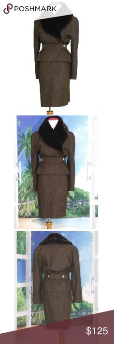 Mansfield Tweed Wasp Waist Skirt Suit Faux Fur Manufacture Date: Estimated 1980s, and inspired by the 1940's - 1950's war time era.  Vintage Size: US 8, EUR 36, UK 10 Contemporary Size: Size 6 to 8 Color: Brown (Dark chocolate and caramel) Outer Shell: 100% pure virgin wool Lining: 100% acetate Trim: Detachable fur fabric (faux Mink fur)  Label: Mansfield Clothes of London  The plush brown faux fur collar is held in place with buttons and is removable. The suit has an asymmetric shawl lapel…