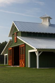 Metal Barn: Which is Better Deciding the correct way to build a barn will be entirely dependent upon what you plan on using it for. Choose Wood Barn if you want better insulation and metal barn if you want durability. Metal Building Homes, Building A House, Metal Barn Homes, Metal Horse Barns, Morton Building, Design Garage, House Design, Barn With Living Quarters, Pole Barn Garage
