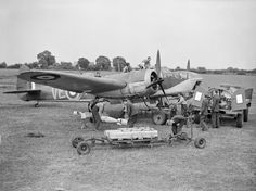 Bristol Blenheim Mark IV, of No. 110 Squadron RAF, at RAF Wattisham, Suffolk. Armourers unload GP bombs and Small Bomb Containers (SBCs) of incendiaries from a trolley, while other ground-crew refuel the aircraft. Aircraft Photos, Ww2 Aircraft, Military Aircraft, Bristol Blenheim, Ww2 Planes, Vintage Airplanes, Battle Of Britain, Royal Air Force, World War Two