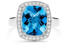 Coast White Gold Elongated Cushion Blue Topaz Ring @ Calvin's Fine Jewelry