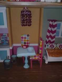 The table was a basic square piece of wood glued to an unfinished candlestick (both from Hobby Lobby). We used the bedroom wall color to tie the fabric and the rooms together. The chairs are some basic wood pieces that I nailed together in a simple fram Custom Woodworking, Woodworking Projects Plans, Barbie Furniture, Dollhouse Furniture, J Birds, Barbie Kitchen, Kids Inspire, American Girl Crafts, Bedroom Wall Colors