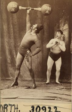 Strongman Herbert Bosworth and an admirer, ca. 1890