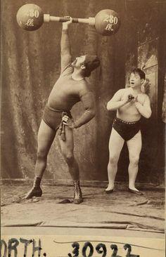 Strongman Herbert Bosworth and an admirer, ca. 1890