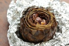 How to roast whole artichokes flavored with garlic, lemon, and oil. These oven-roasted whole artichokes are easy to make and absolutely delicious! Roasted Artichoke Recipe, Roasted Artichokes, Artichoke Recipes, Roasted Garlic, Roasted Cauliflower, Artichoke Soup, Artichoke Hearts, Tasty, Yummy Food