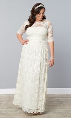 Feel beautiful on your big day in our plus size Lace Illusion Wedding Dress!  www.kiyonna.com  #KiyonnaPlusYou  #MadeintheUSA  #Bridal