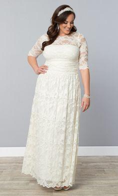 Feel beautiful on your big day in our plus size Lace Illusion Wedding Dress!  www.kiyonna.com  #KiyonnaPlusYou  #MadeintheUSA  #Bridal