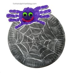 This handprint spider andpaper plate watercolor resist web makes a spooky yet cute Halloween decoration.  How to make the Handprint Spider: My little guy wanted a purple spider this year. Paintonehand minus the thumb and press down onto paper. Paint the other hand the same way. Press down overlapping the palm area of the...