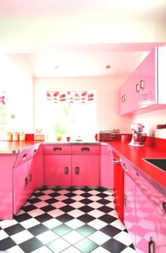 We love the pink cabinets and checkerboard floor of this kitchen!