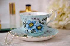 Very pretty set in a pale blue with slightly darker blue flowers on the front, back and inside the teacup.  This set is in excellent vintage
