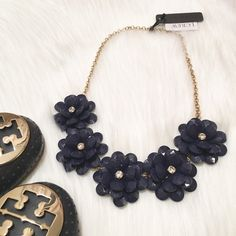 """NWT J. Crew Crystal Floral Burst Necklace! *will add my own photos tonight! Stock photo exact representation of item for sale. NWT J. Crew Crystal Floral Burst Necklace! Comes with J. Crew jewelry dust pouch. SO adorable- the perfect statement necklace for spring or summer! Color: Navy blue. DETAILS: Zinc casting, acrylic bead, steel chain, glass stone, cubic zirconia. Light gold ox plating. Length: 21"""". J. Crew Jewelry Necklaces"""