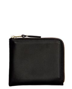 Comme des Garcons half-zip wallet in classic black - amazing quality, and perfectly simple. - March 2013