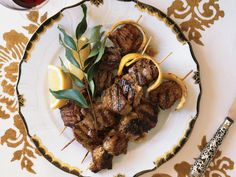 Yogurt-Marinated Lamb Kebabs With Lemon Butter | Marinating lamb kebabs in yogurt makes them extra tender, and basting the meat with lemon butter just before serving adds an extra layer of bright flavor.