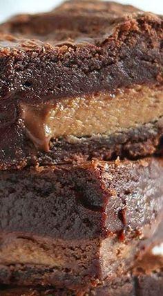 These are the BEST peanut butter brownies ever! They have peanut butter throughout AND are stuffed with peanut butter cups! Thick, fudgy, chewy, and gooey.