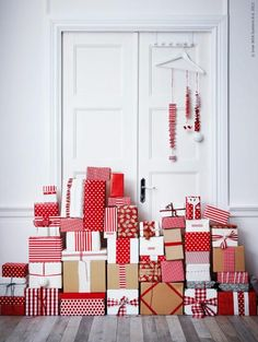 Wrap Presents Uniformly...seeee even Ikea says you're supposed to wrap presents in like colors, patterns, etc...why does everyone tease me about the fact that I do this, it's part if my home decor for an entire month I want it to match!