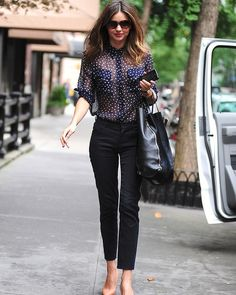Miranda Kerr looks impossibly chic as she dashes to the shops.