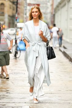 Sweet dreams: Adding to the angelic colour scheme of the ensemble was a fitted plain white top underneath, while she gave her usually heel-clad feet a rest with ballet flats